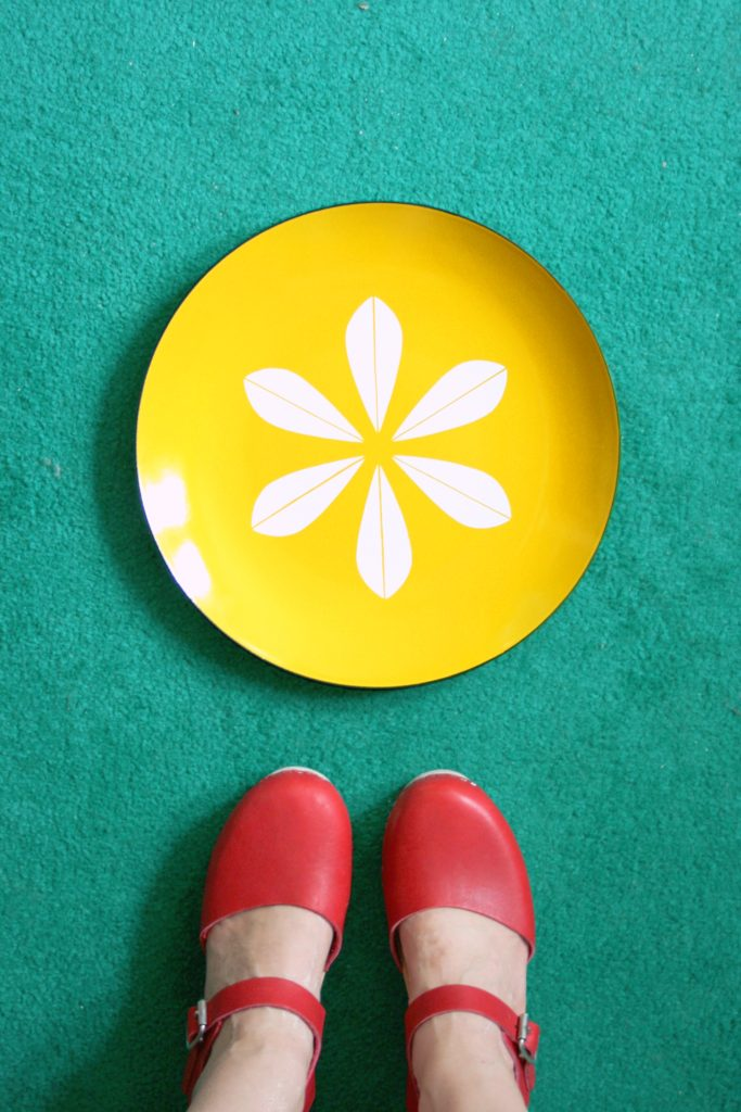 My very first piece of Cathrineholm enamelware - a bright yellow charger plate.